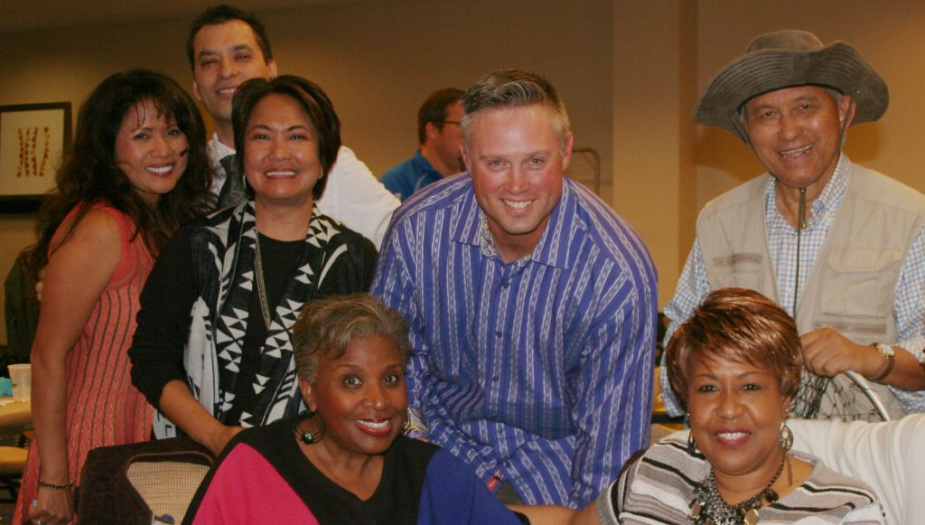 Michael Cuddyer, center; MMM Founder Dr. Juan Montero, right; and supporters